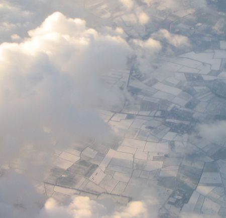 Airplane view of fields in snow